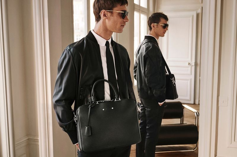 French model Clément Chabernaud takes hold of Louis Vuitton's Armand briefcase.