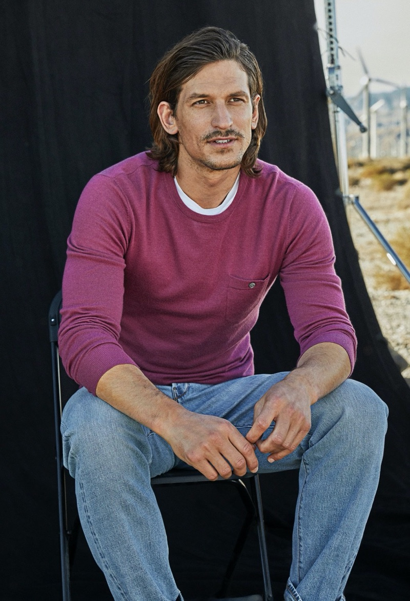 Front and center, Jarrod Scott sports an Italian cashmere pocket t-shirt sweater from Todd Snyder in magenta mist.