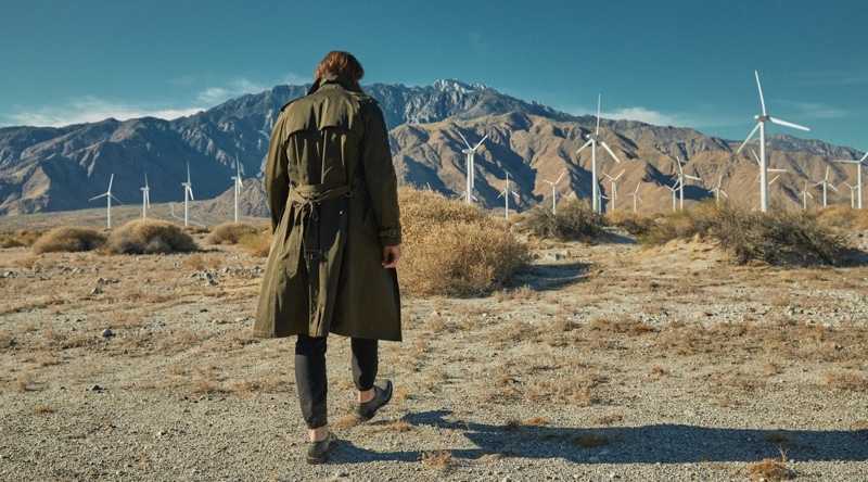 Taking to the desert, Jarrod Scott wears a Todd Snyder + Private White V.C. trench coat in olive with Todd Snyder drawstring stretch joggers.