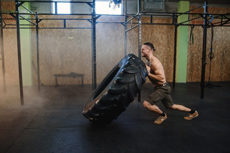 Man Exercising with Tire
