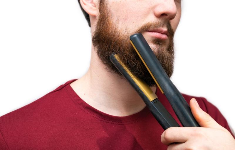 Man Straightening Beard Flat Iron