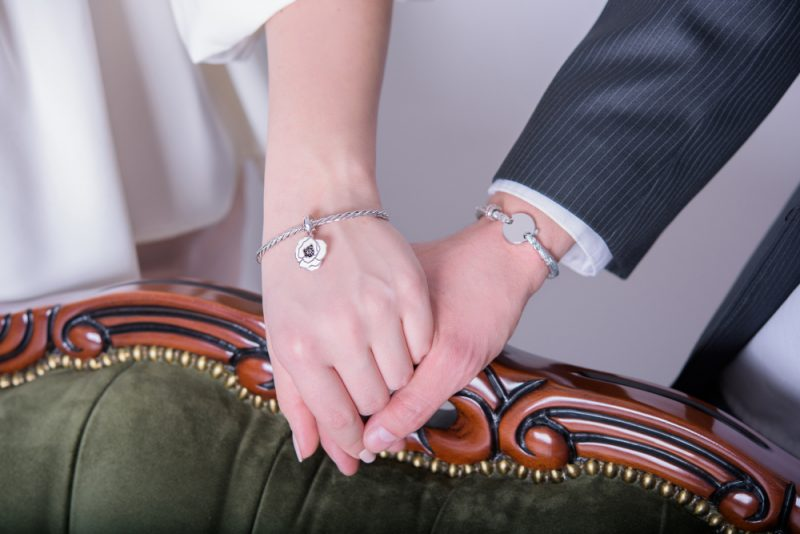 Man Woman Holding Hands with Bracelets