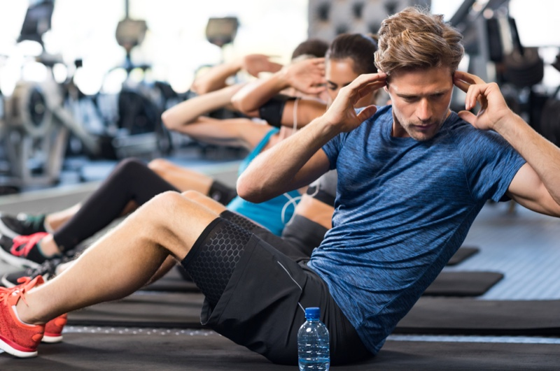 Man Working Out Sit Ups Water Bottle