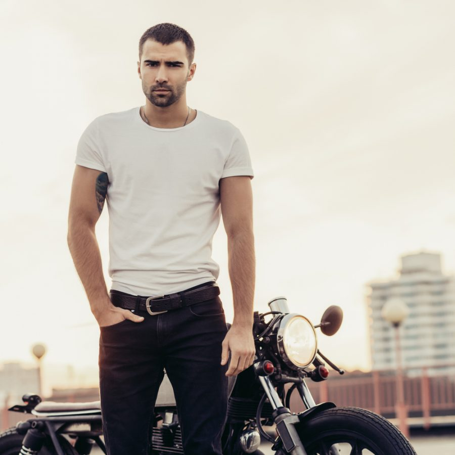 Man in Plain T-Shirt and Jeans by Motorcycle