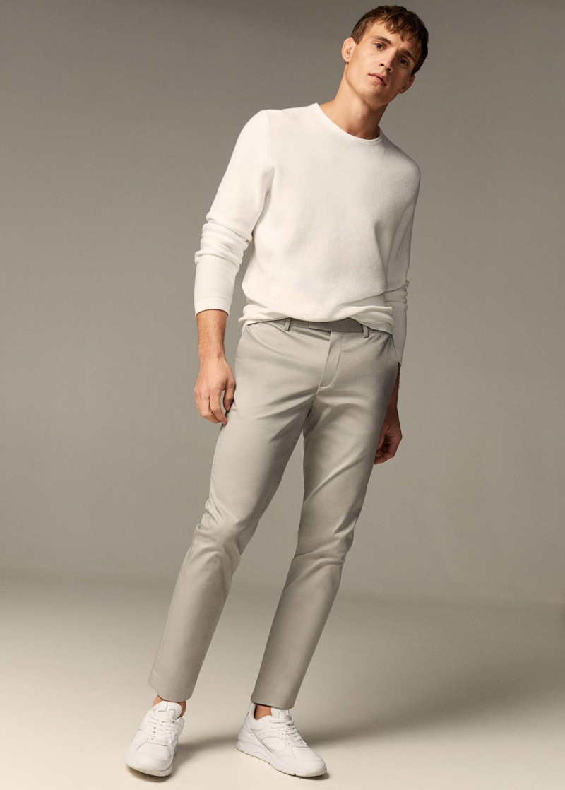 Julian Schneyder dons a neutral-colored look from Mango.