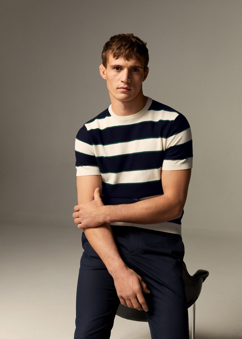 Connecting with Mango, Julian Schneyder sports a striped short-sleeve knit.