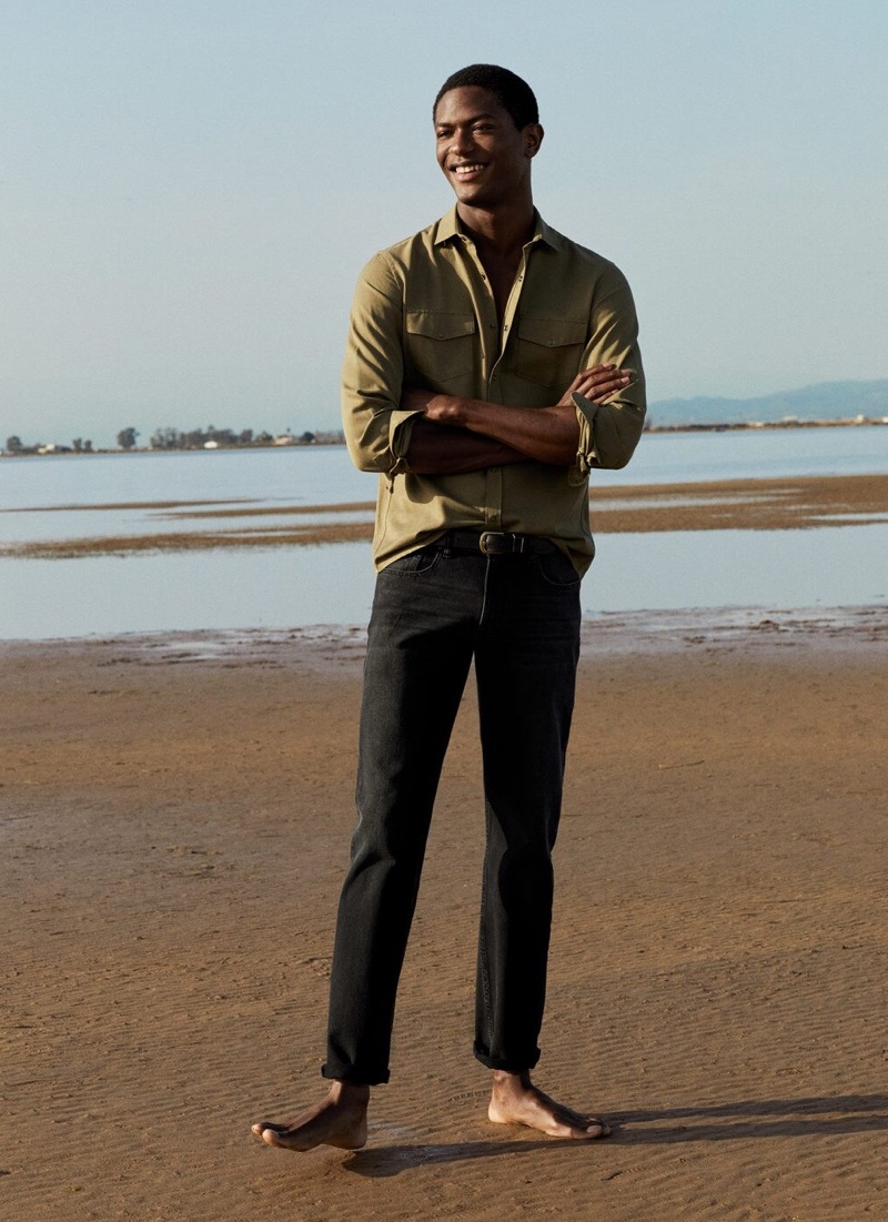 Hitting the beach, Hamid Onifade poses in a fresh outfit from Mango.