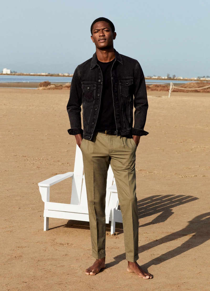 Pleated trousers easily dress up a black Mango jean jacket as worn by Hamid Onifade.