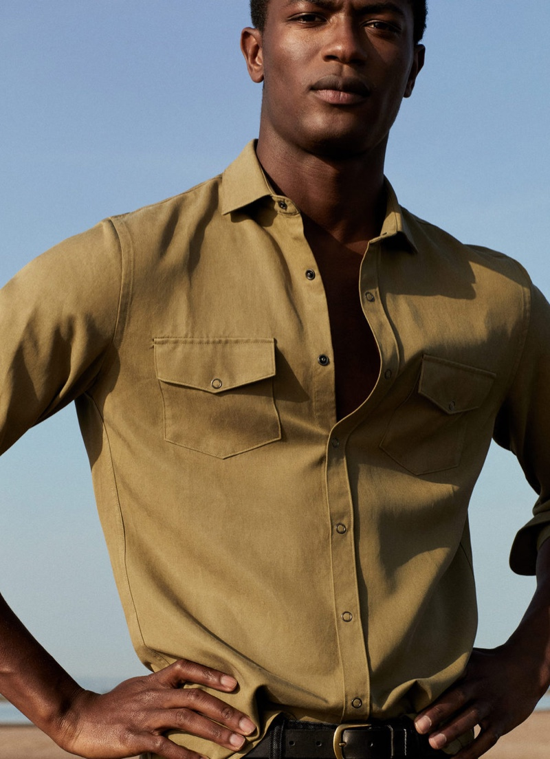 Front and center, Hamid Onifade sports a spring shirt from Mango.