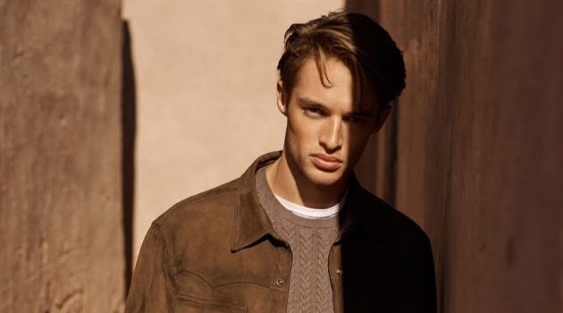 Embracing shades of brown, Morton Nielsen wears a suede shirt jacket with a cable-knit sweater.