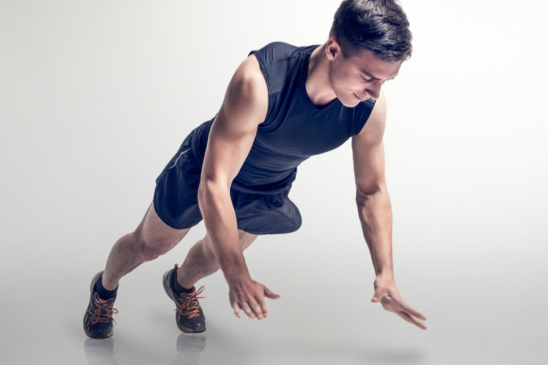 Muscular Man Working Out Gym Clothes