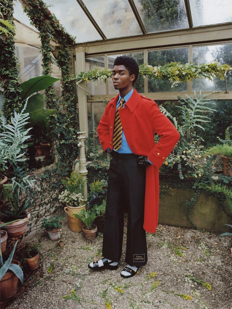 Standing out in a red coat, Alton Mason models Gucci for Nordstrom.