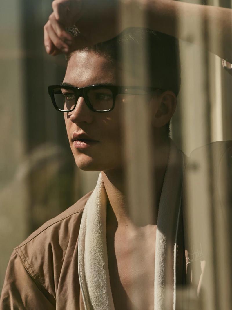A smart vision in black framed glasses, Hero Fiennes-Tiffin stars in Oliver Peoples' spring-summer 2020 campaign.