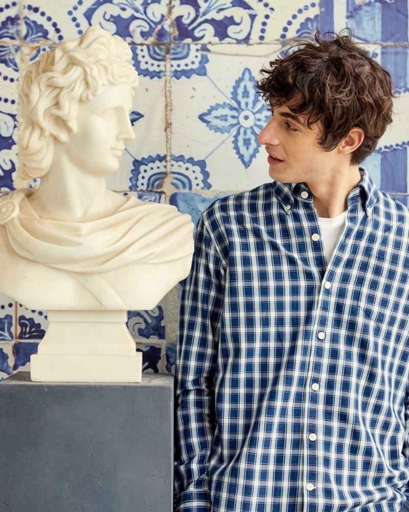 Connecting with GANT, Oscar Kindelan models the brand's Hugger shirt.