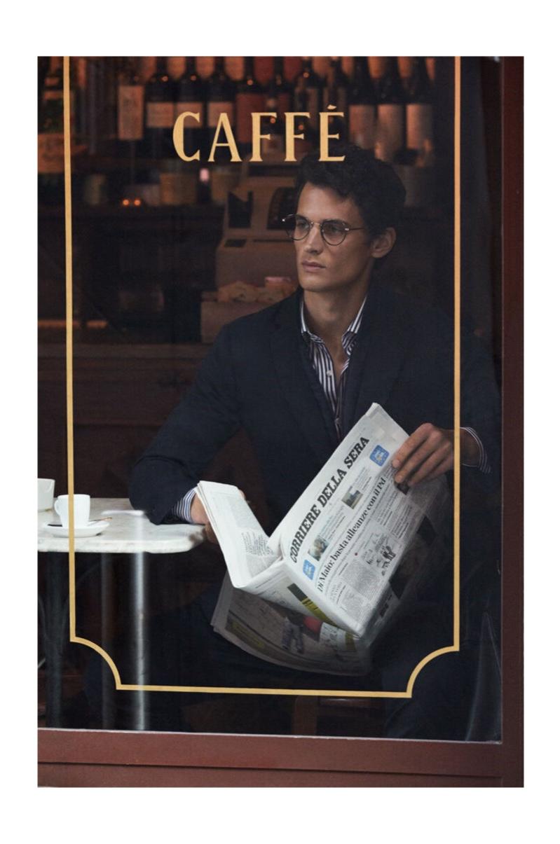 Making time for an espresso and a newspaper, Garrett Neff wears Pedro del Hiero.