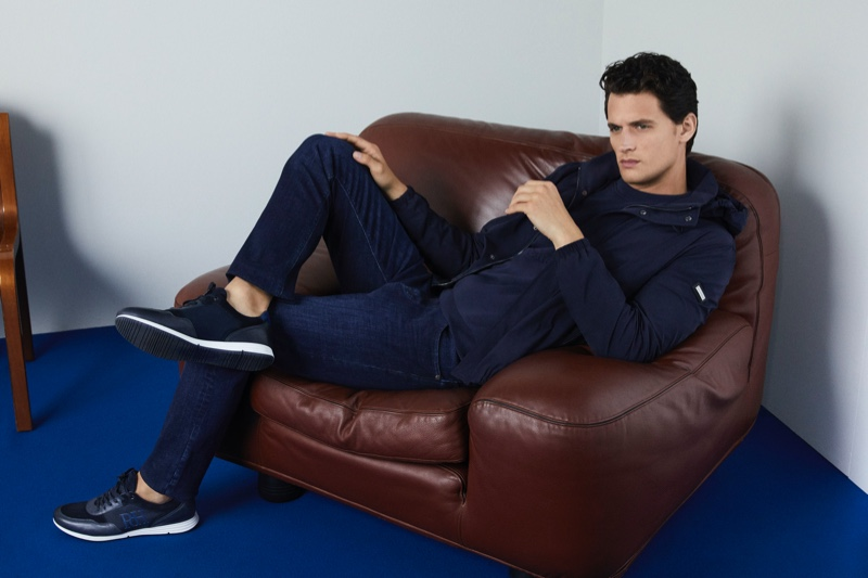 Opting for a casual business look ala Friday, Garrett Neff models a look from Pedro del Hierro for its spring-summer 2020 campaign.