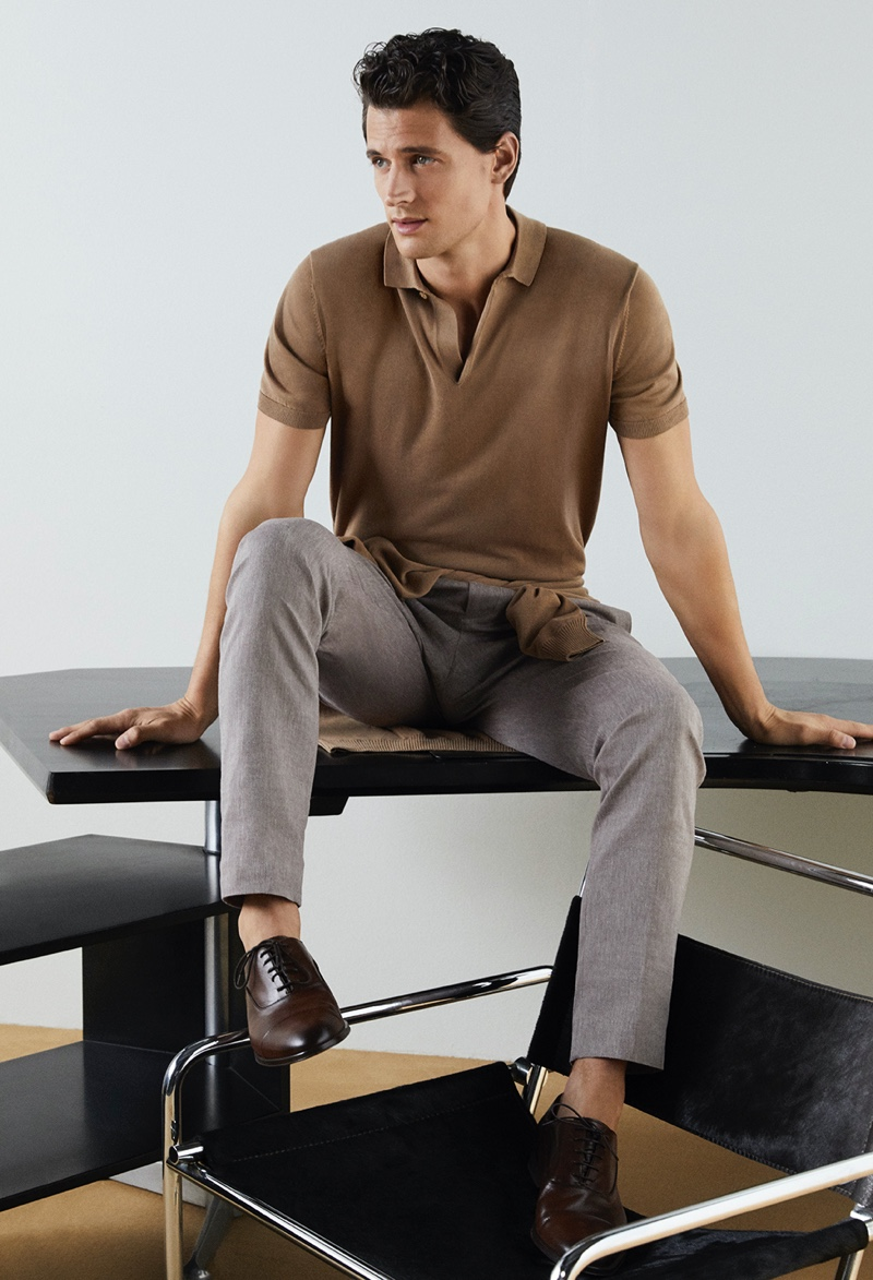 Front and center, Garrett Neff dons a brown polo and smart trousers from Pedro del Hierro for its spring-summer 2020 campaign.