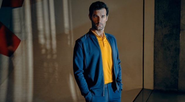 Embracing blue and yellow, Mark Webber fronts the Porsche x BOSS spring-summer 2020 campaign.