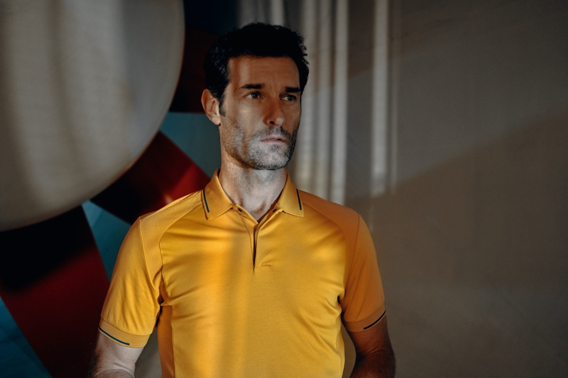 Sporting a yellow polo shirt, Mark Webber appears in the Porsche x BOSS spring-summer 2020 campaign.