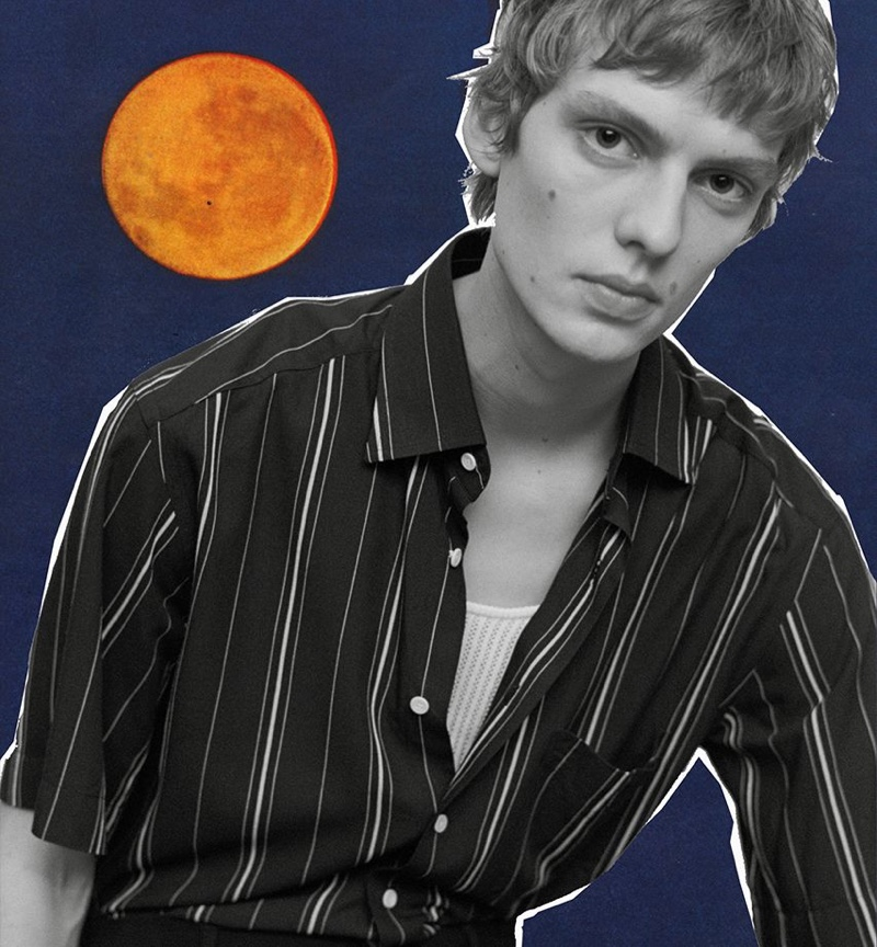 Leon Dame models a striped short-sleeve shirt for Sandro's spring-summer 2020 campaign.