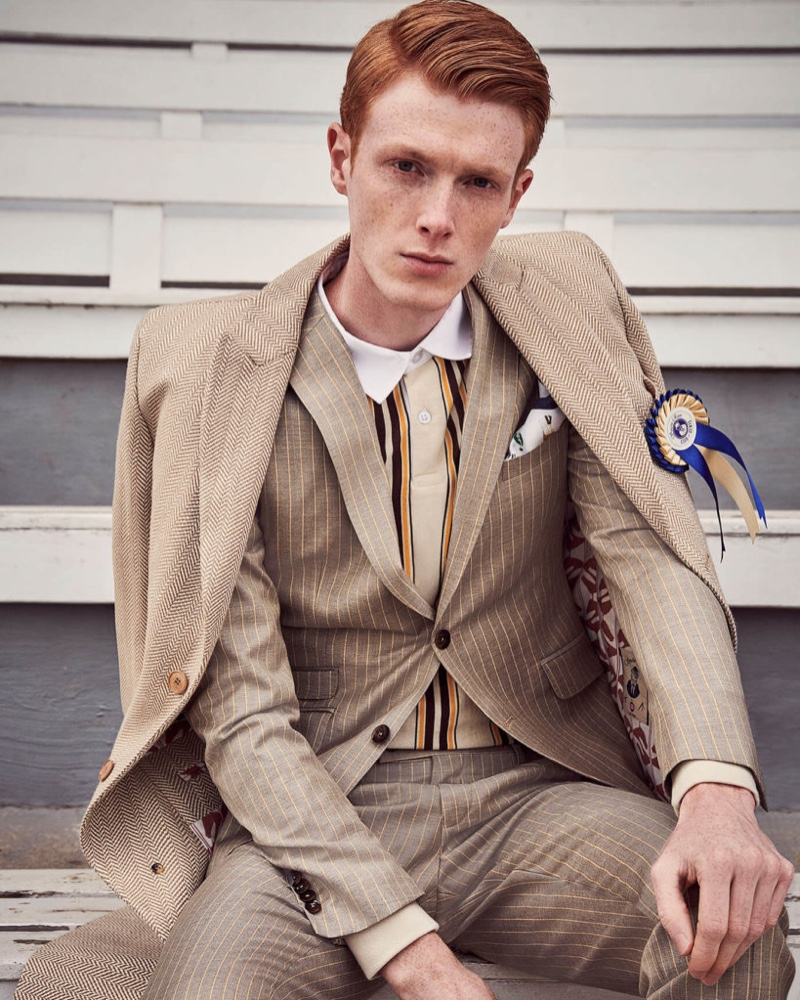 Embracing a neutral color scheme, Linus Wordemann wears a smashing look from Savile Row by CG.