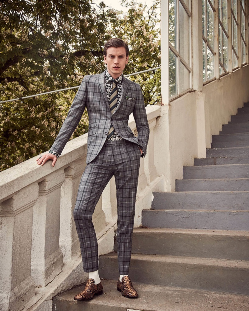 Donning a checked suit, Sid Ellisdon wears Savile Row by CG.