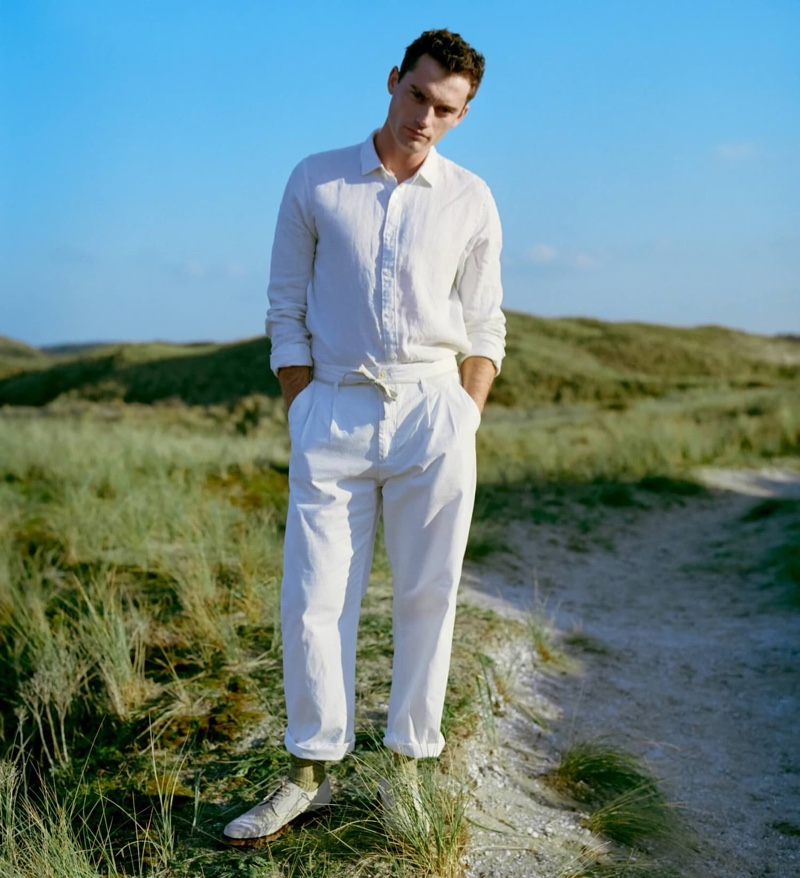 Harrison Griffiths dons a linen shirt with loose tapered fit pleated chinos from Scotch & Soda.