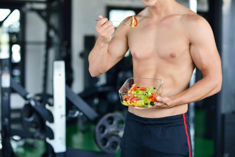 Shirtless Man Eating Salad