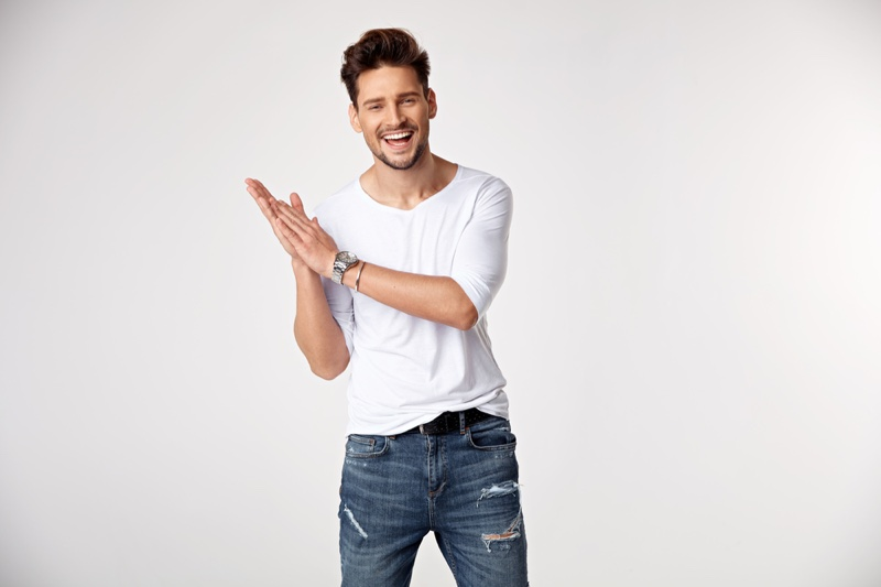 Smiling Male Model Forma Fitting White Shirt Distressed Jeans