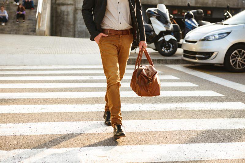 Stylish Man Walking Across the Street Cropped
