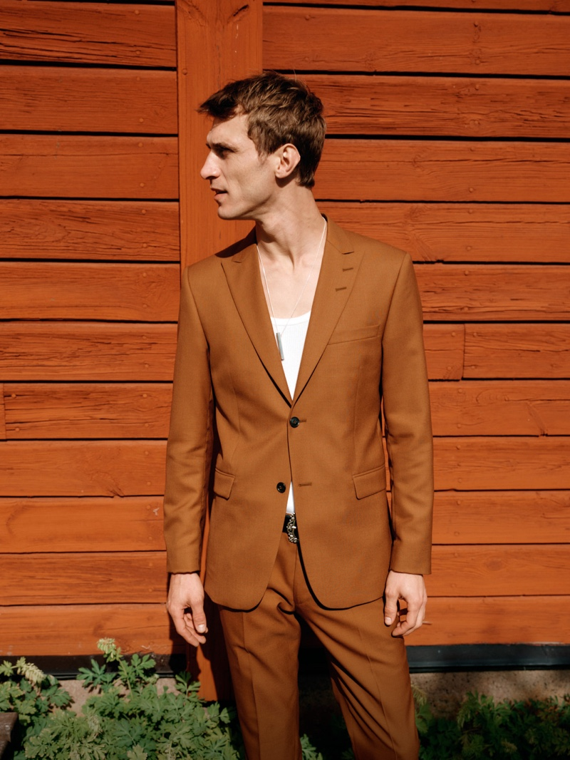 Sporting a brown suit, Clément Chabernaud fronts Tiger of Sweden's spring-summer 2020 campaign.