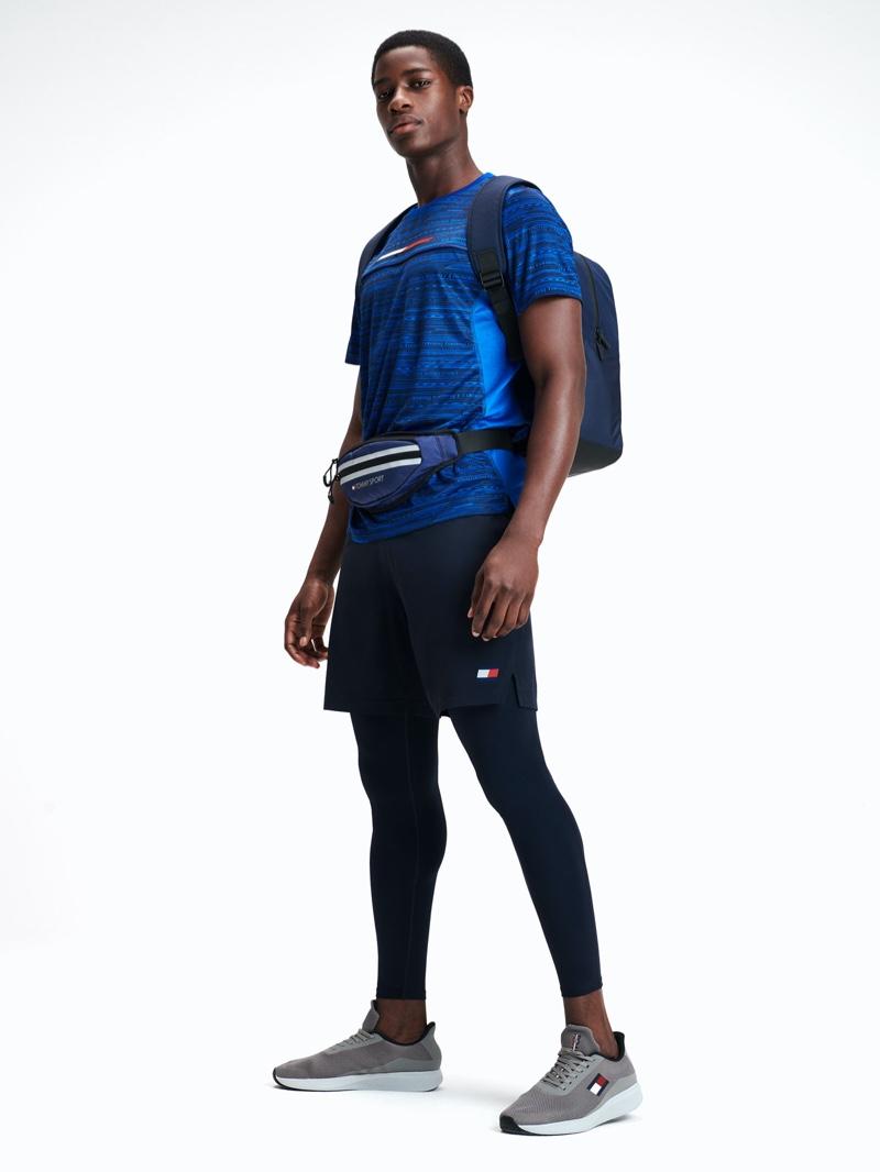 Making a case for blue and black, James Kakonge models Tommy Sport for spring-summer 2020.