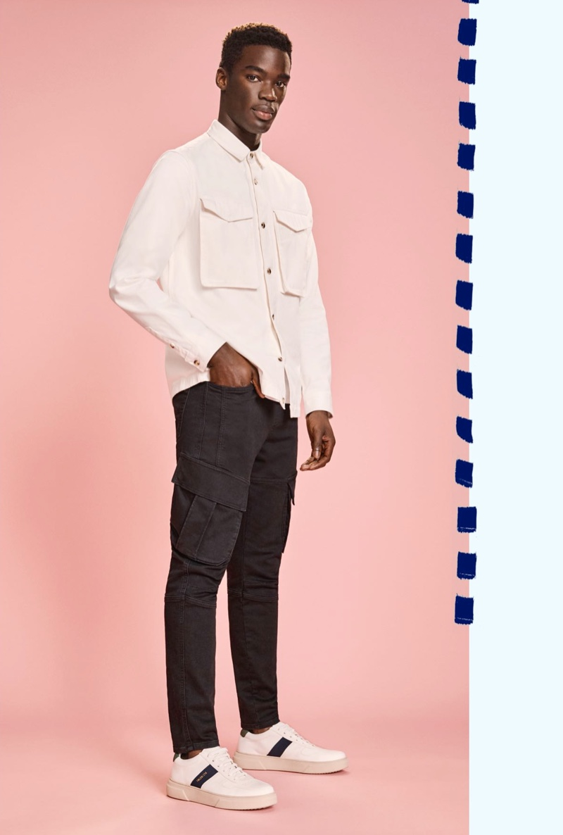 Hitting the studio, Brady Asumang models cargo jeans for Topman's denim campaign.
