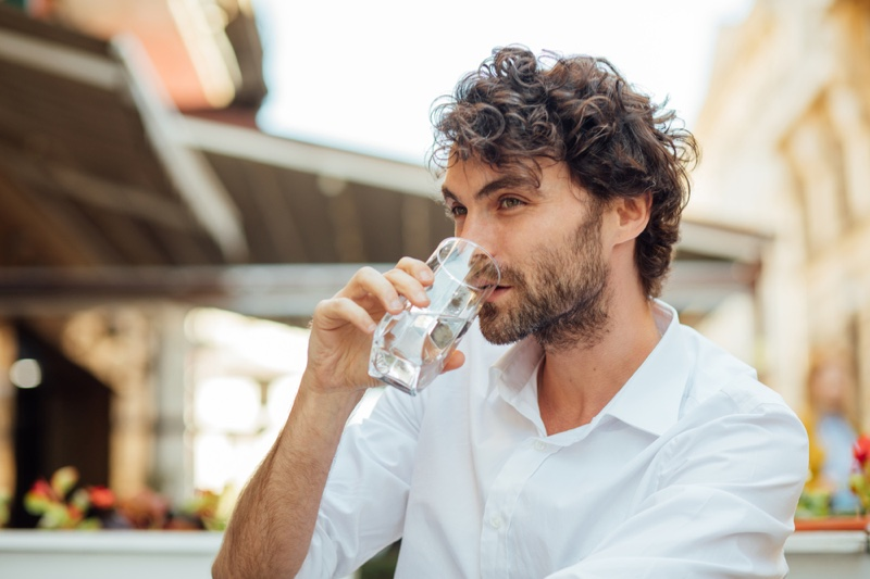 Attractive Man Drinking Water Curly Hair
