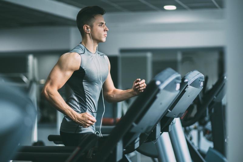 Attractive Man Running Tank Top Treadmill Earphones
