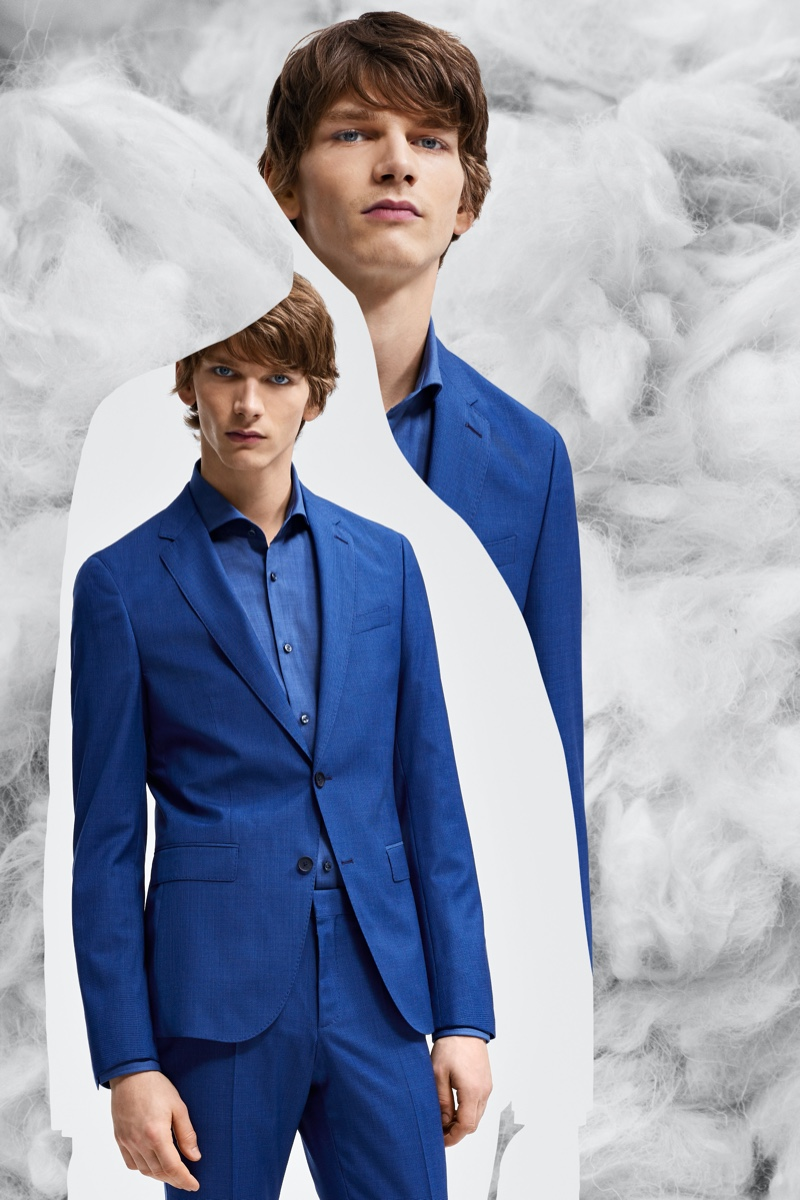 Erik Van Gils dons a blue suit from BOSS' Responsible Tailoring collection.