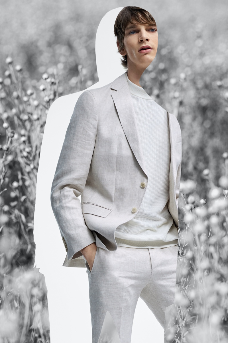 Embracing neutrals, Erik Van Gils dons a sleek suit number from BOSS' Responsible Tailoring collection.