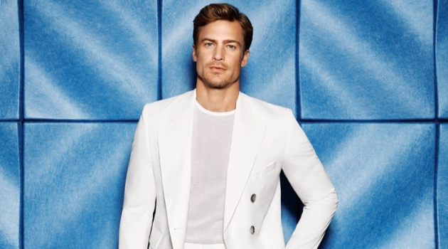 A clean summer vision, Jason Morgan models a virgin wool double-breasted suit by BOSS for Holt Renfrew.