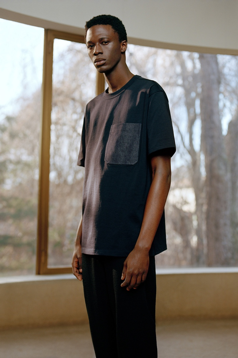 Cherif Douamba dons a casual look in black from COS' spring-summer 2020 collection.