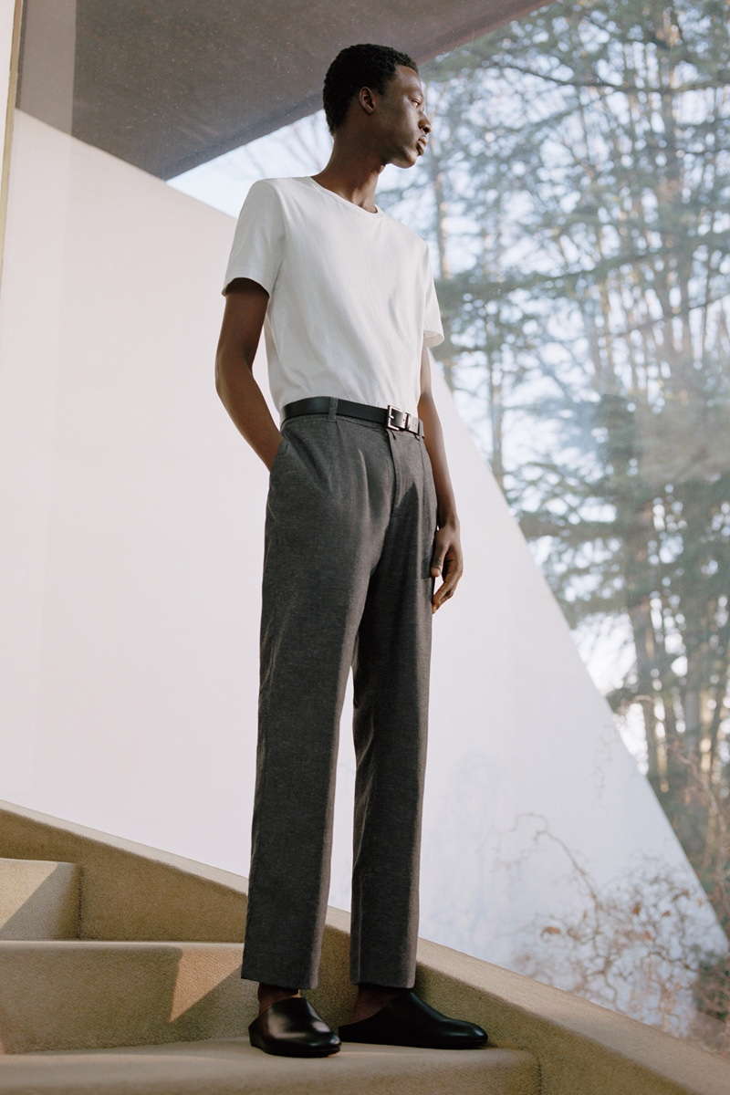 Going minimal, Cherif Douamba dons a t-shirt with gray trousers from COS.