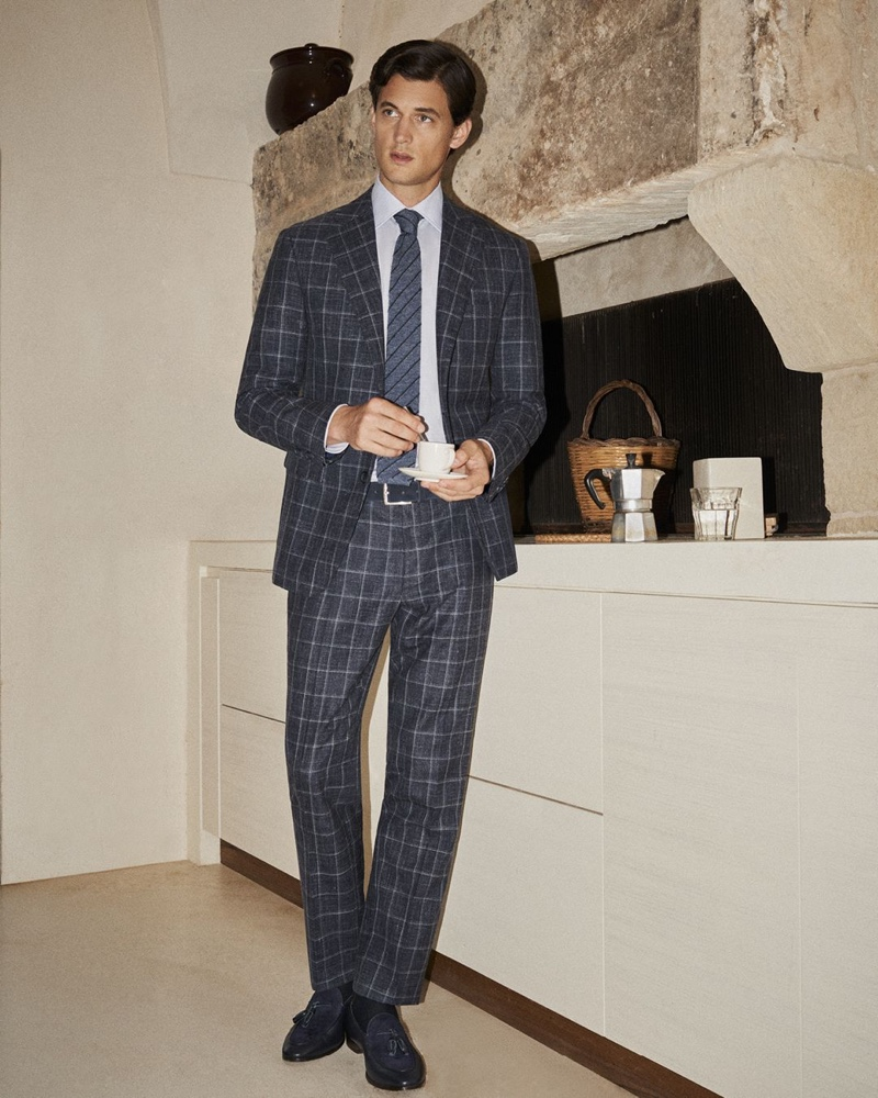 Garrett Neff dons a checked suit for Canali's spring-summer 2020 campaign.