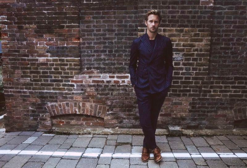 Dashing in a navy pinstripe suit, Alexander Skarsgård appears in Clarks' spring-summer 2020 campaign.