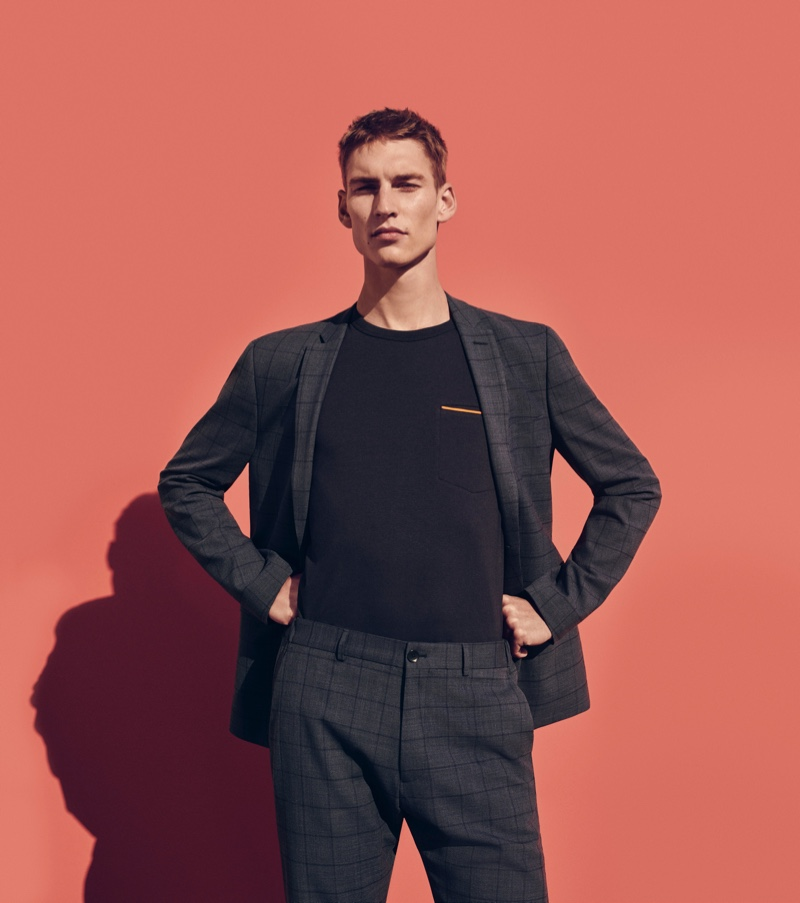 Model Thom Voorintholt wears a windowpane print suit from ESPRIT's spring-summer 2020 collection.