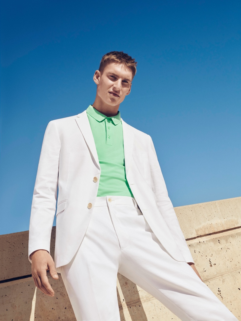 A fresh vision, Thom Voorintholt wears a lime green polo with a white suit by ESPRIT.
