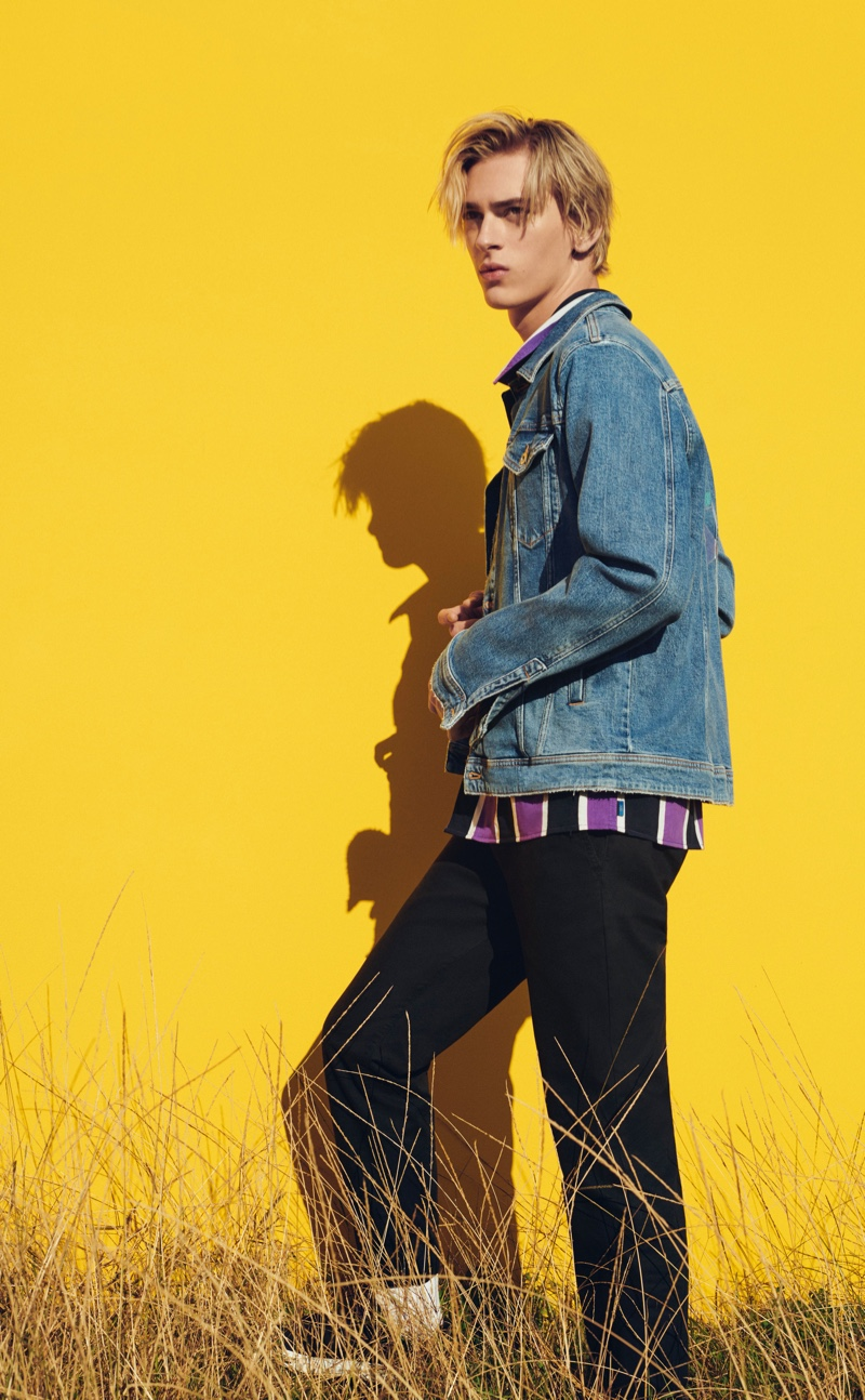 Dominik Sadoch rocks a denim jean jacket with a striped shirt and pants from ESPRIT.