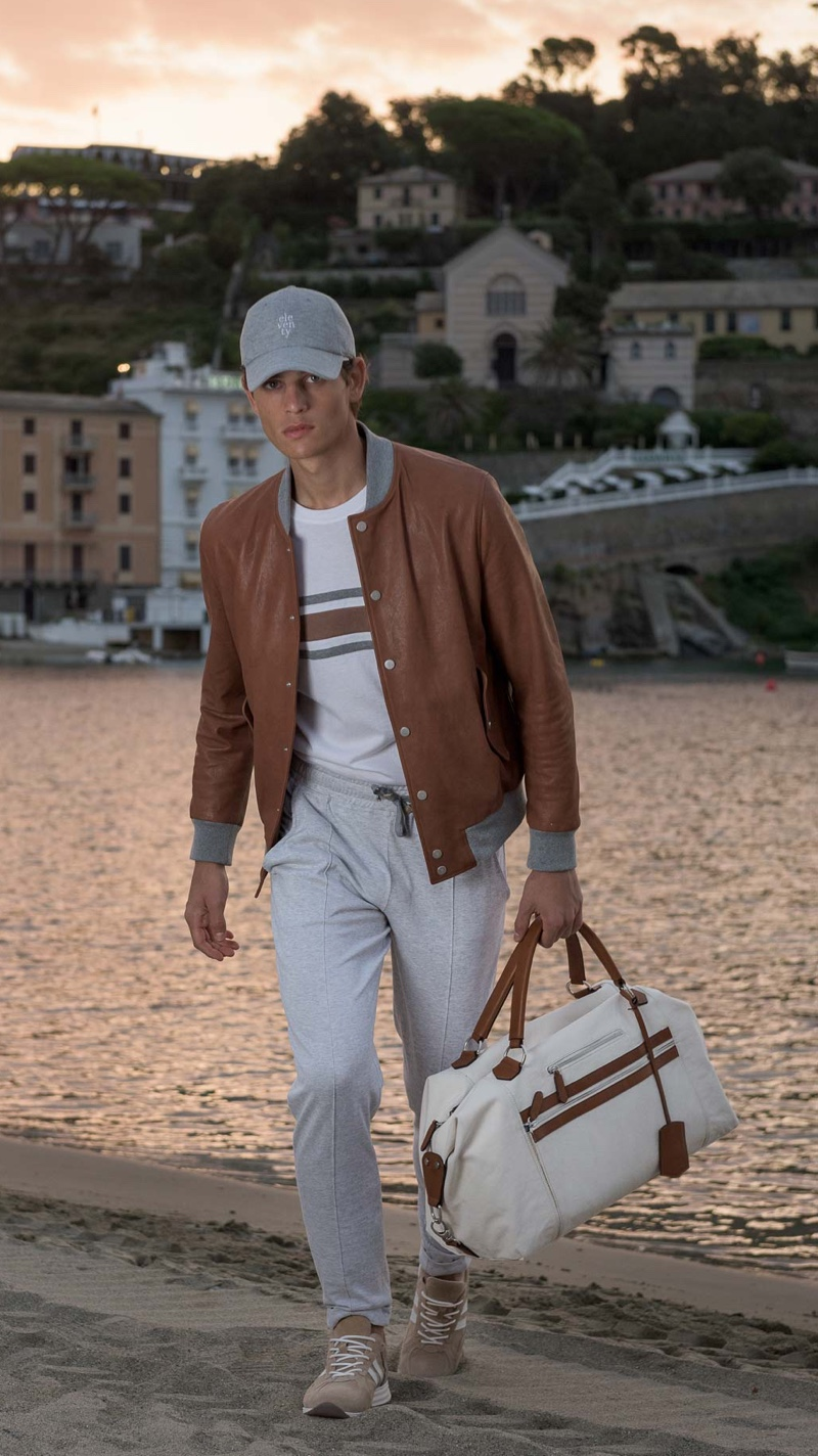 On the move, Pau Ramis dons a brown and white look for Eleventy's spring-summer 2020 campaign.