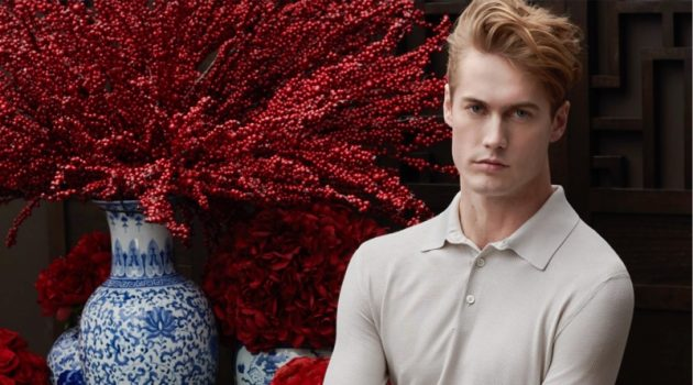 A chic vision, Neels Visser models a long-sleeve polo with pleated trousers from Ermenegildo Zegna for Holt Renfrew.