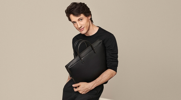 Nicolas Ripoll fronts Furla's spring-summer 2020 campaign. He poses with the Furla Mercurio bag.