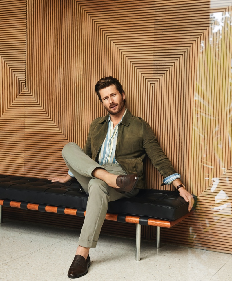 A smart vision, Glen Powell sports a Theory suede bomber jacket, NN07 striped shirt, Torino l'Opificio pants, and Bally loafers for Bloomingdale's spring 2020 Mix Masters campaign.
