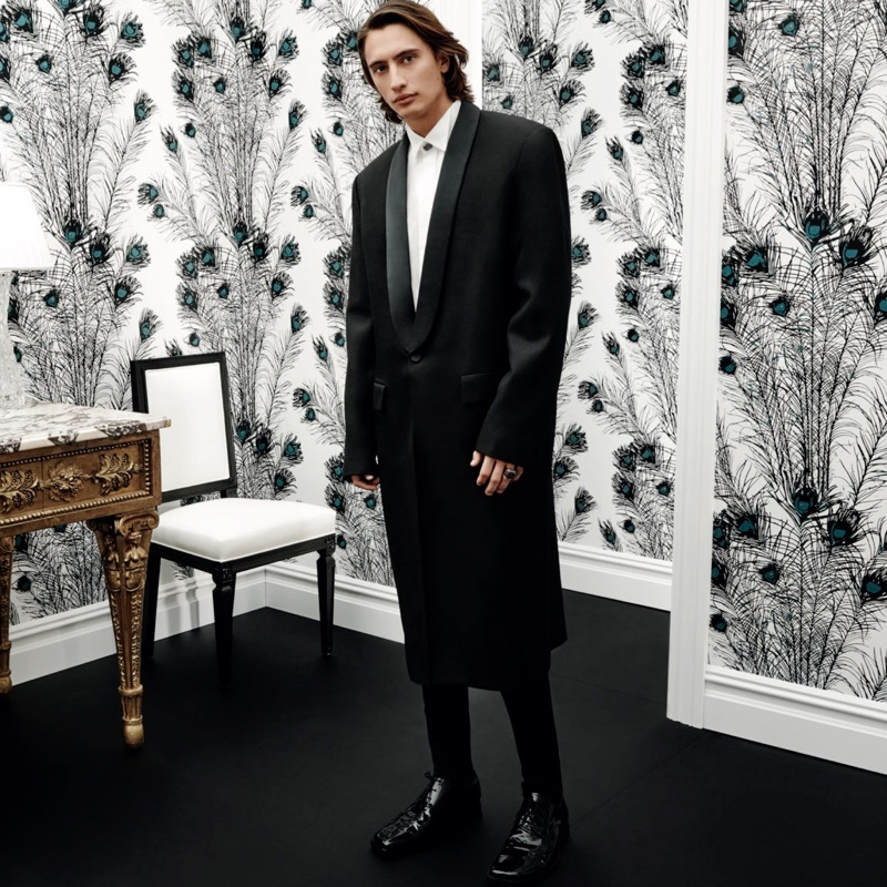 James Turlington wears a tuxedo shirt and coat with tracksuit pants and patent calfskin derby shoes by Balenciaga.